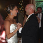 wedding-first-dance-bride-and-groom-smiling-and-laughing
